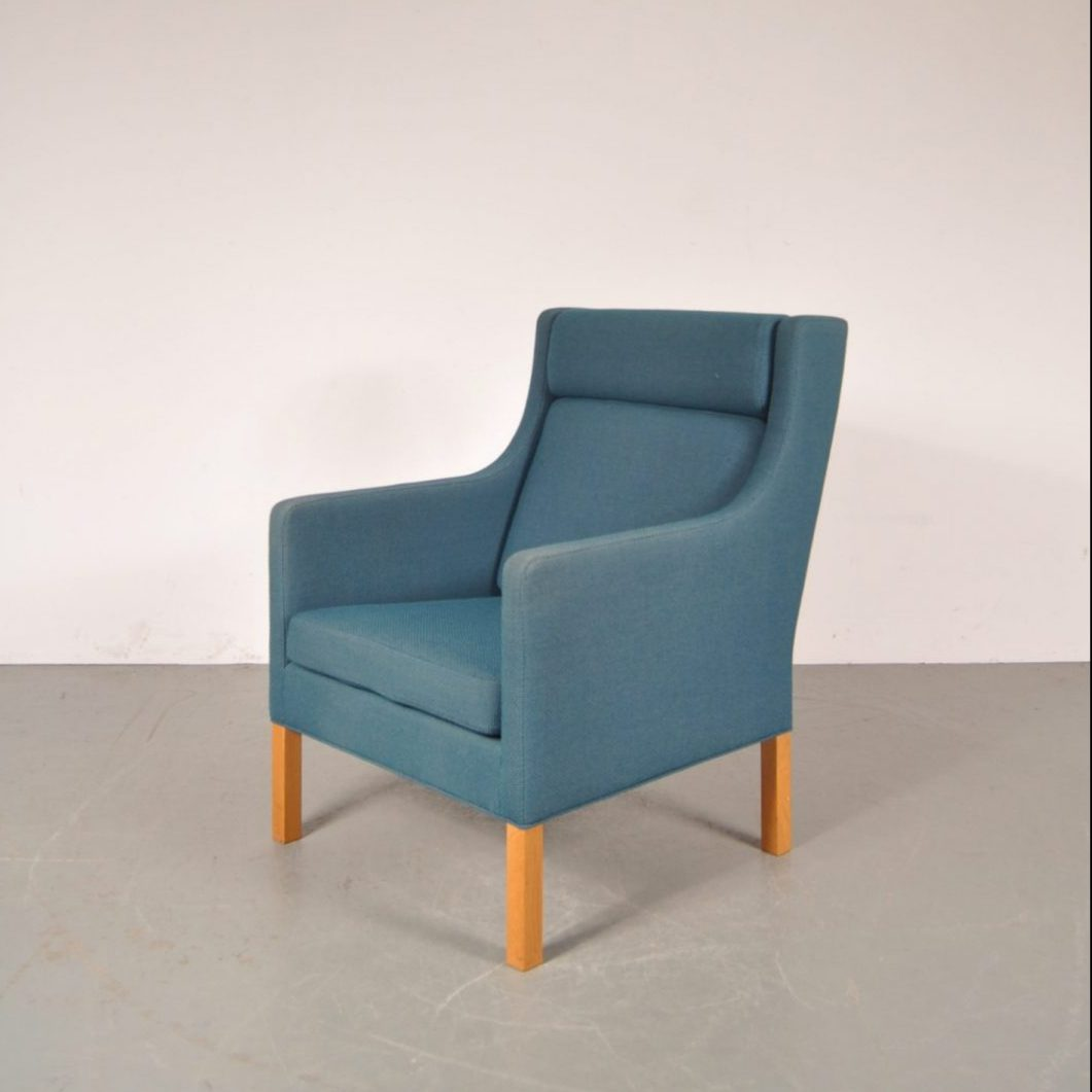 1960's Beautiful Danish highback easy chair with blue fabric upholstery