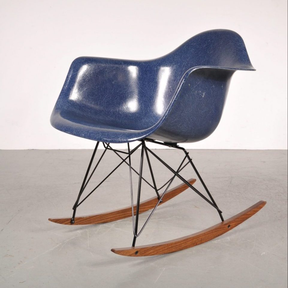1960's Lovely styled rocking chair with blue fiber glass shell on metal with wooden base