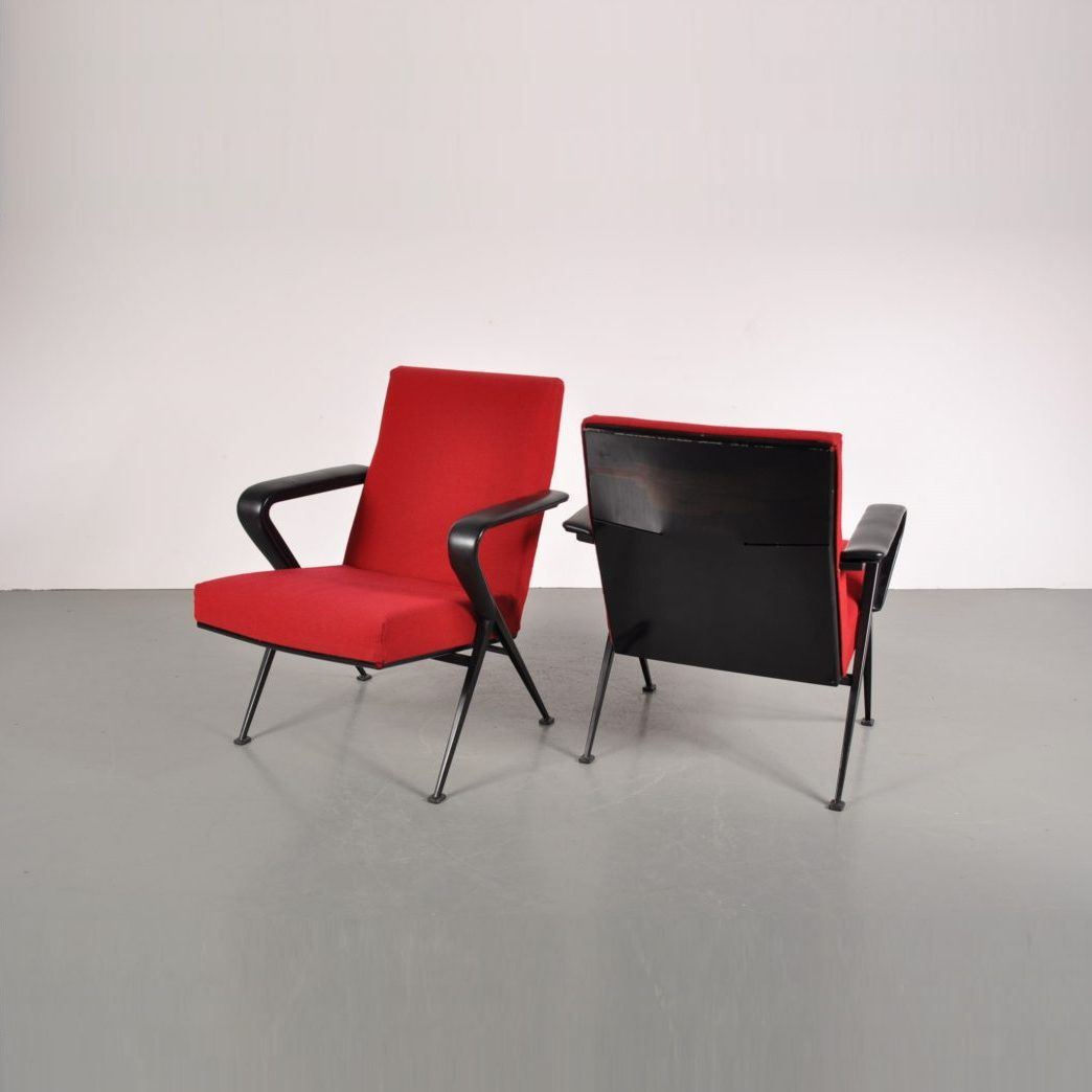 1950's Unique set of two industrial styled easy chairs on black metal base with red upholstery