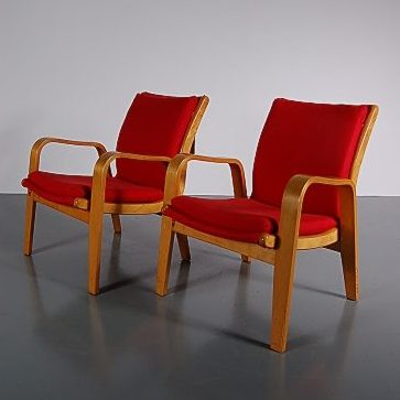 1950's set of 2 lovely styled birch plywood easy chair with new red upholstery