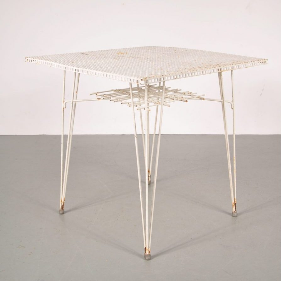1950's Nice styled white perforated metal dining table in the manner of Mategot