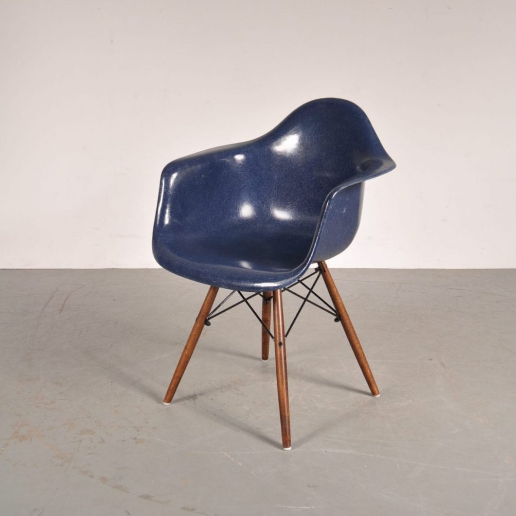 1960's Beautiful blue fiberglass easy chair with wooden dowel base