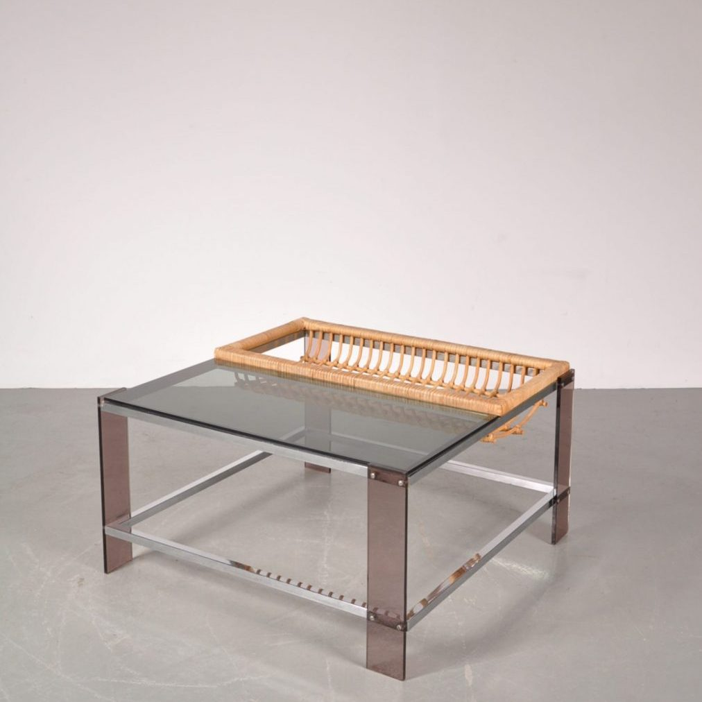 1970's Nice styled coffee table on chrome metal base with smoke glass top and rattan magazine shelf