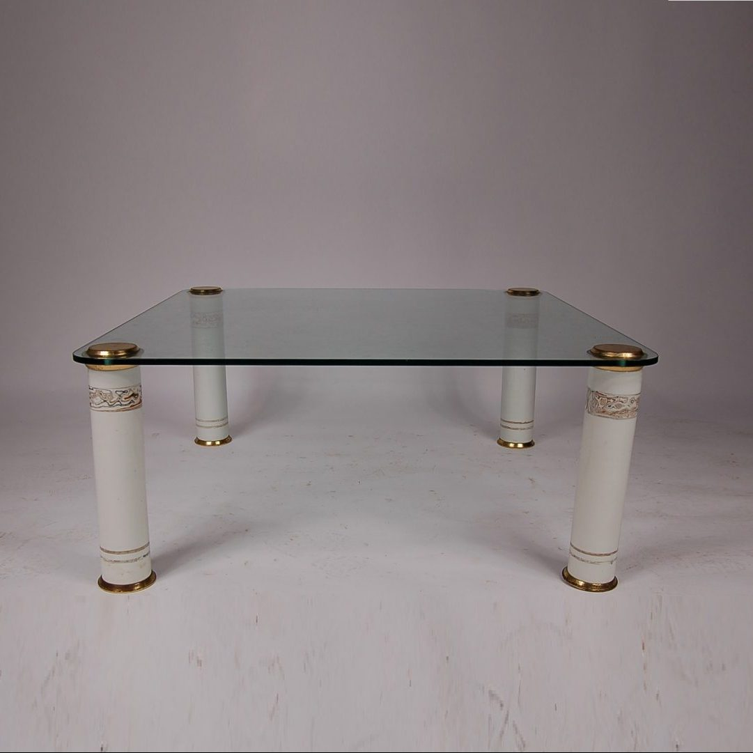 1970's luxury coffee table on messing with ceramic legs with glass top