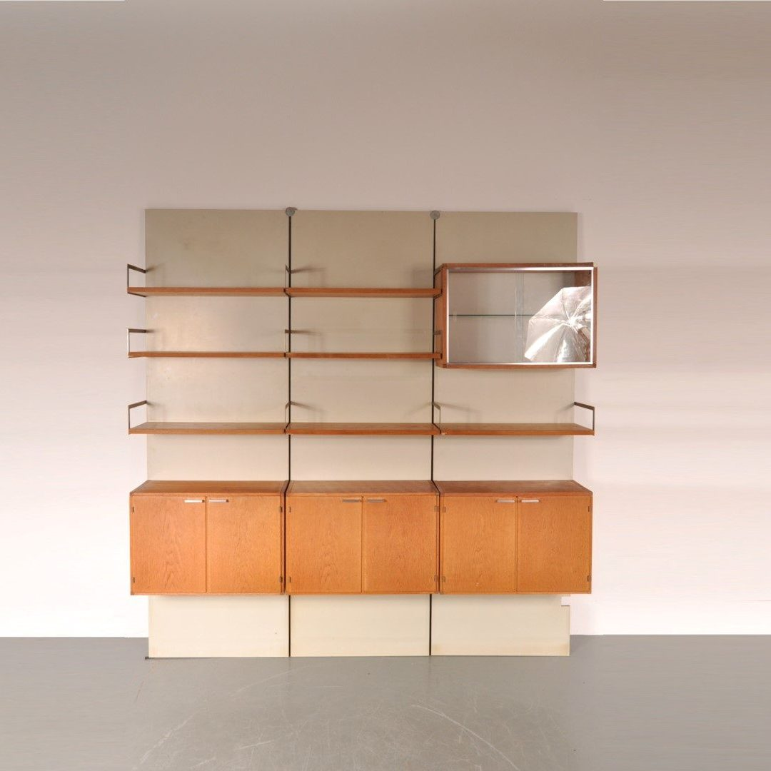 1950's Unique wall mounted system cabinet from the japanese serie Produced: Pastoe/ Netherlands Design: Cees Braakman