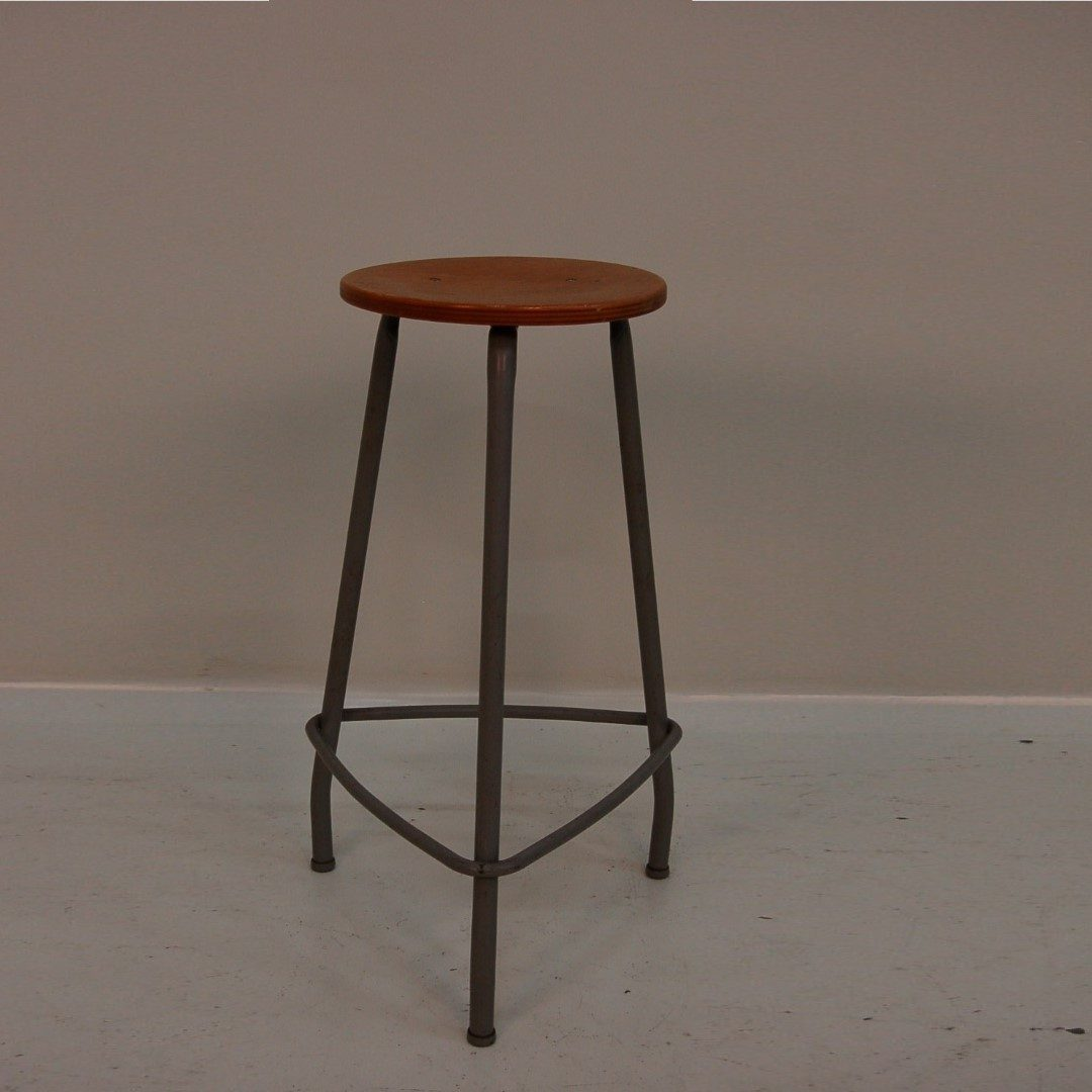 1950's industrial style working stool with grey metal frame and wooden seat Produced: Ahrend de Cirkel / Netherlands