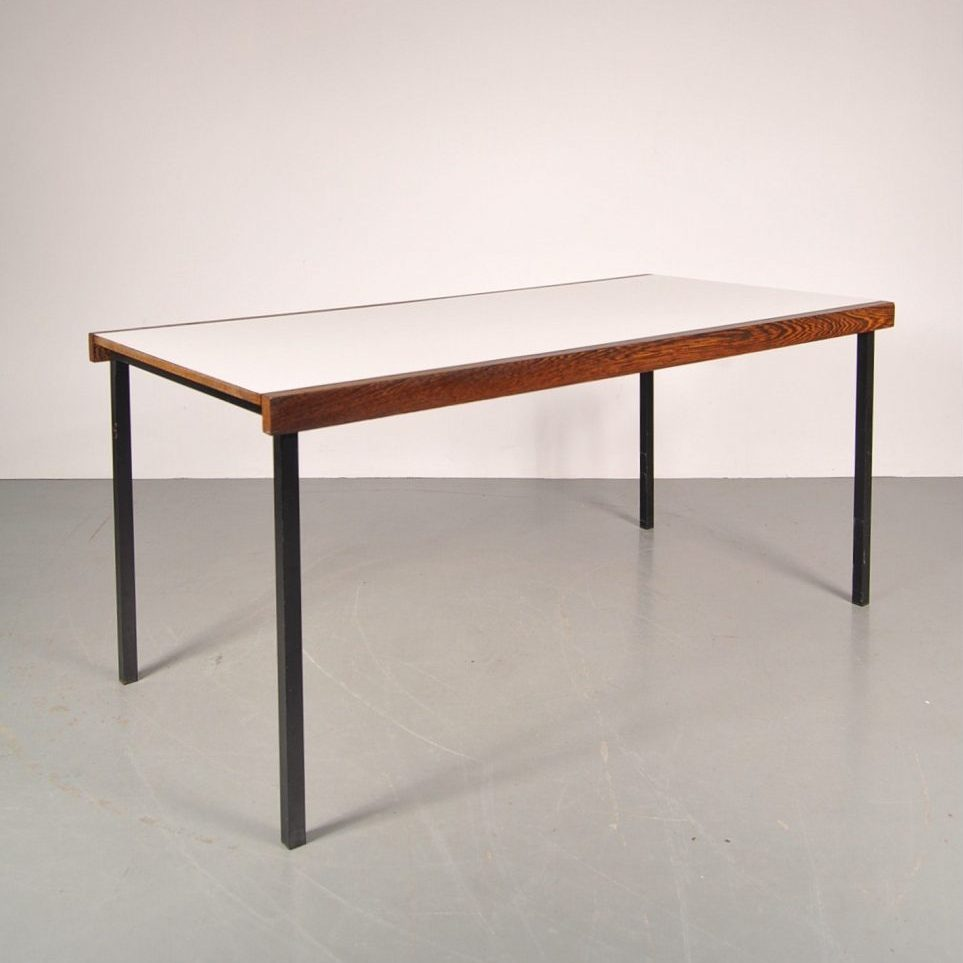 1950's Unique wengé with white laminated dining table on black metal base Produced: Spectrum / Netherlands Design: Martin Visser
