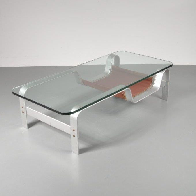 1970s Coffee table with bent chrome metal base, glass top and a leather magazine rack, Norway