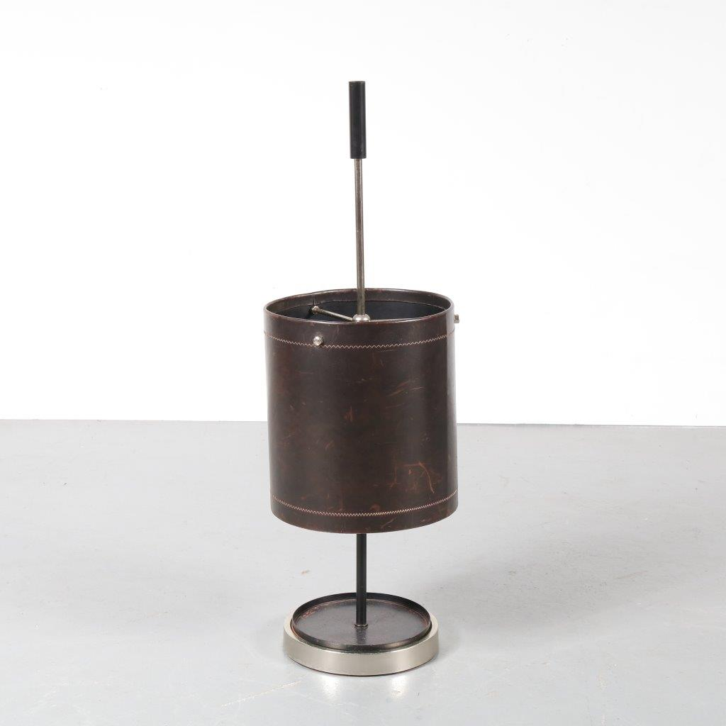 m22907 A beautiful brown leather with chrome metal umbrella stand