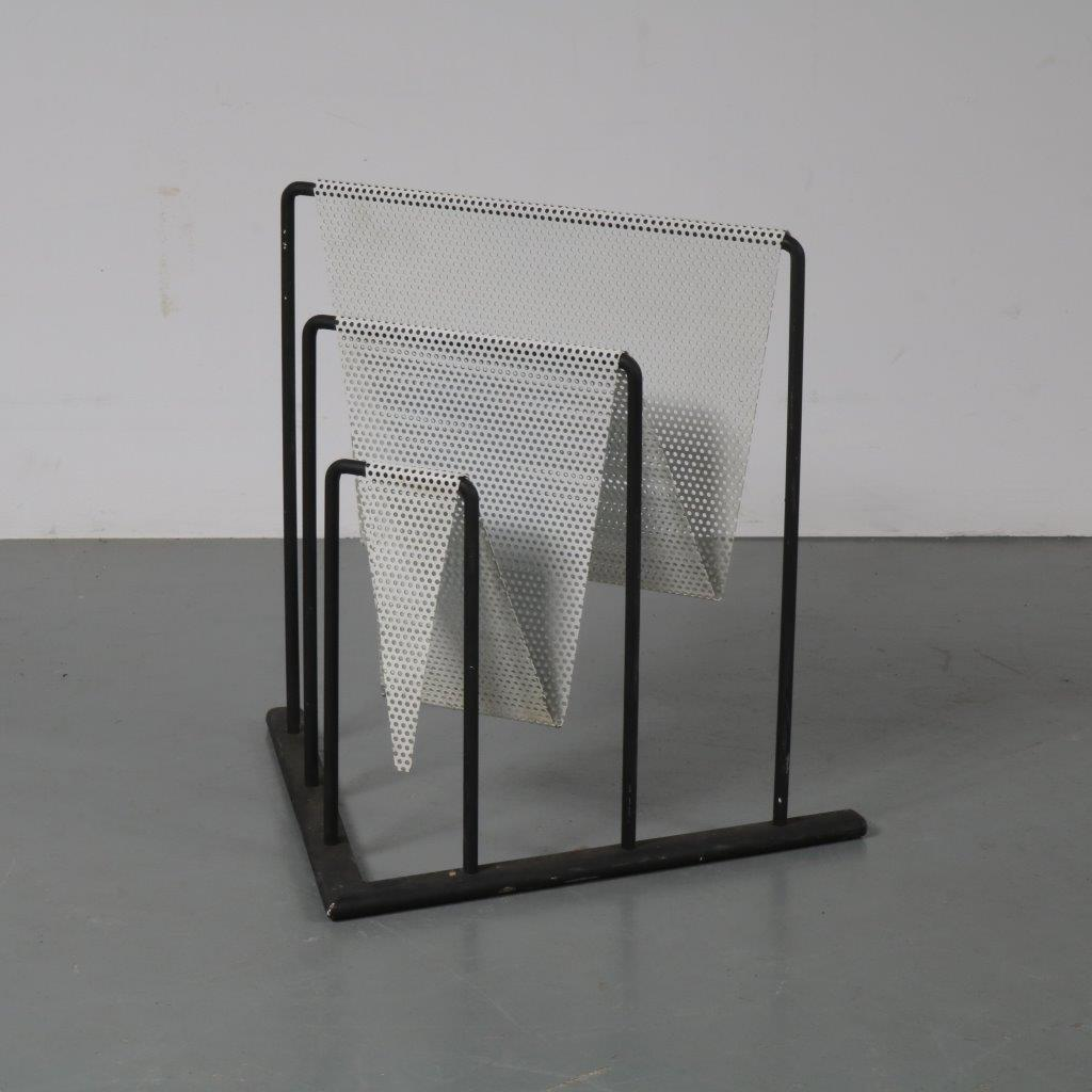 m22754 1950s Magazine rack, black with white perforated metal Pilastro attributed
