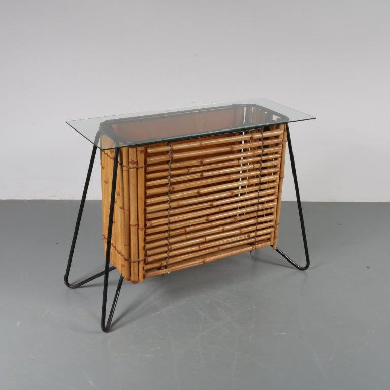 m22841 1950s Rattan cabinet on black metal wire base and glass top