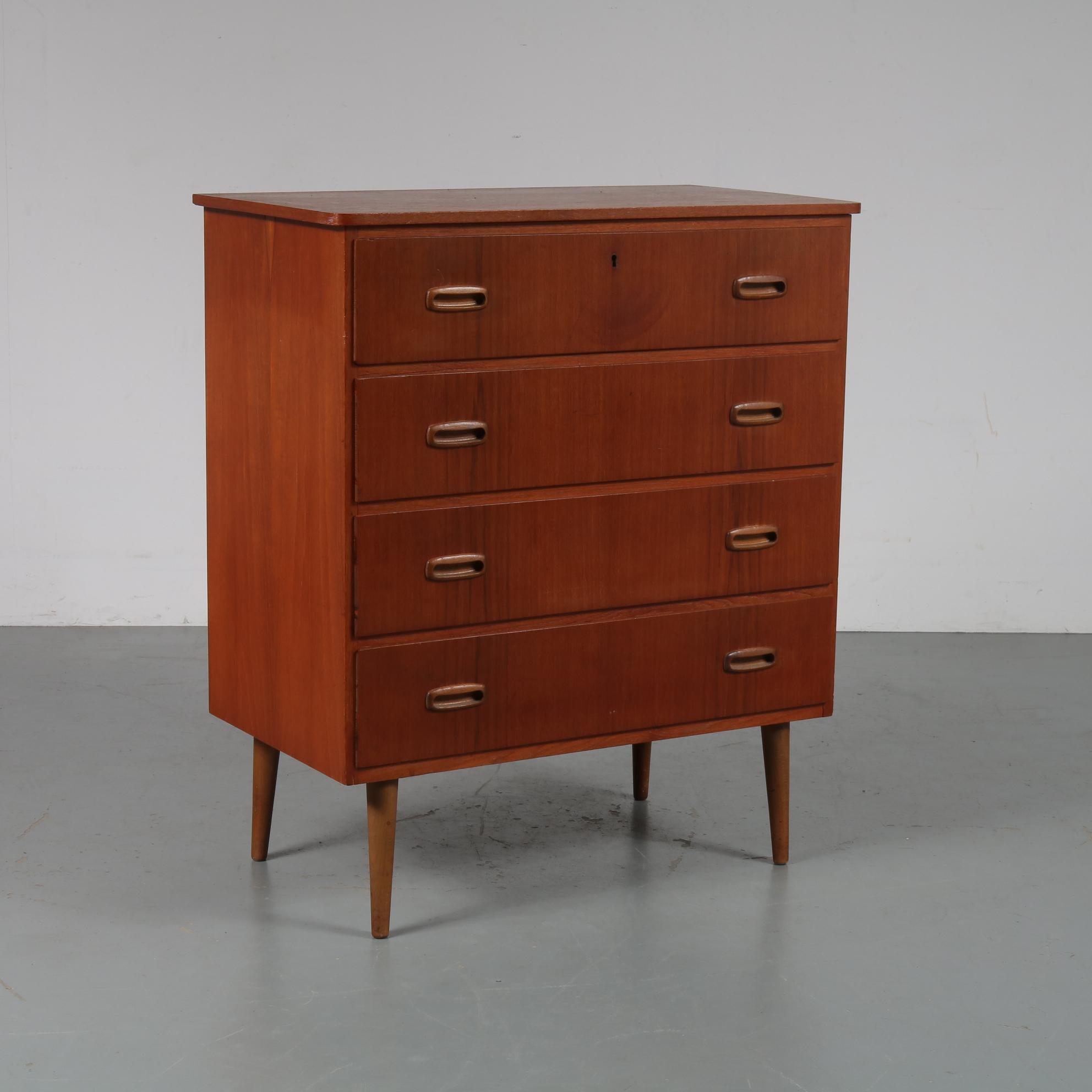 m23080 1950s Teak drawer cabinet on round legs Netherlands