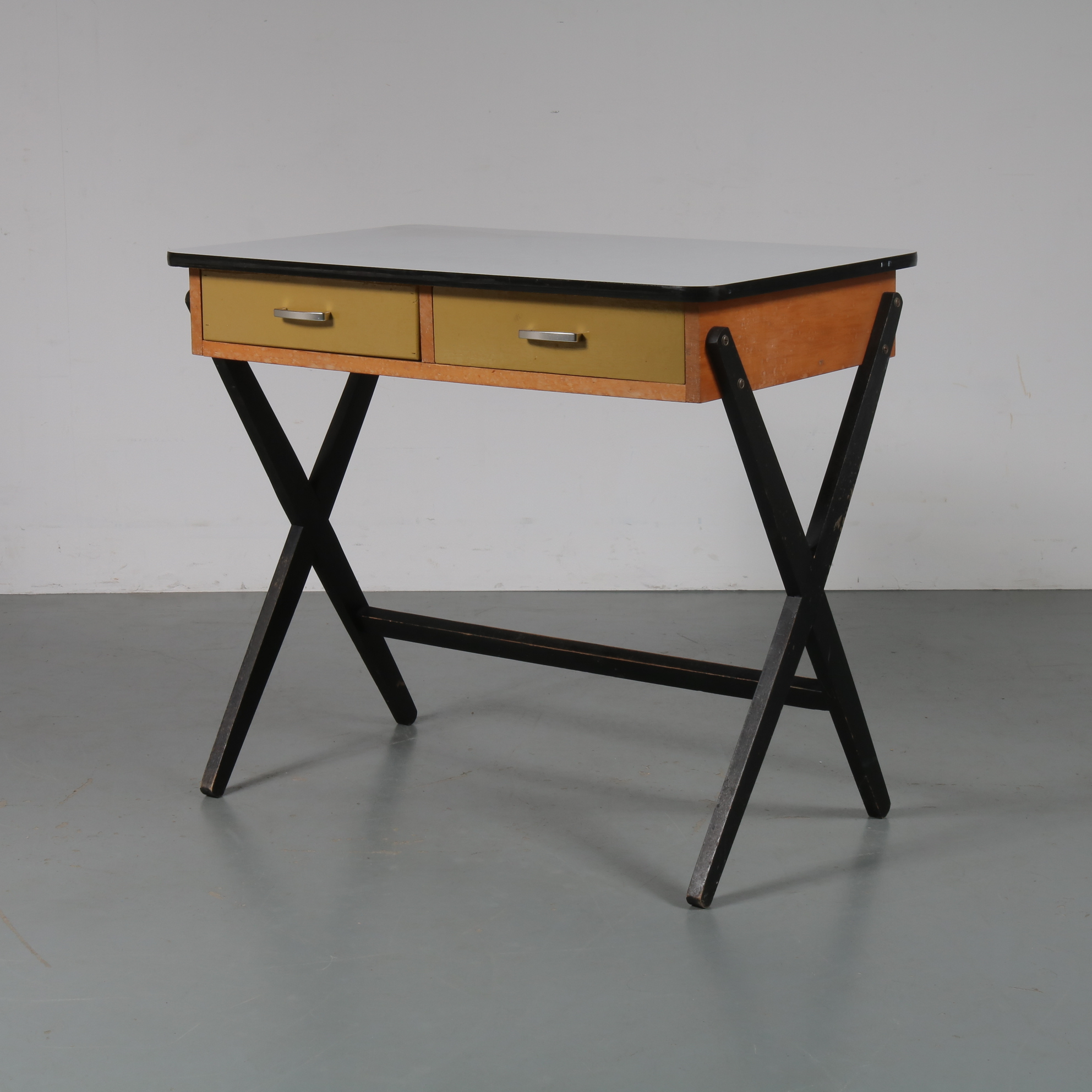m23079 1950s Small wooden desk with black X-legs, yellow drawers and laminated wooden top Coen de Vries Everest / Netherlands