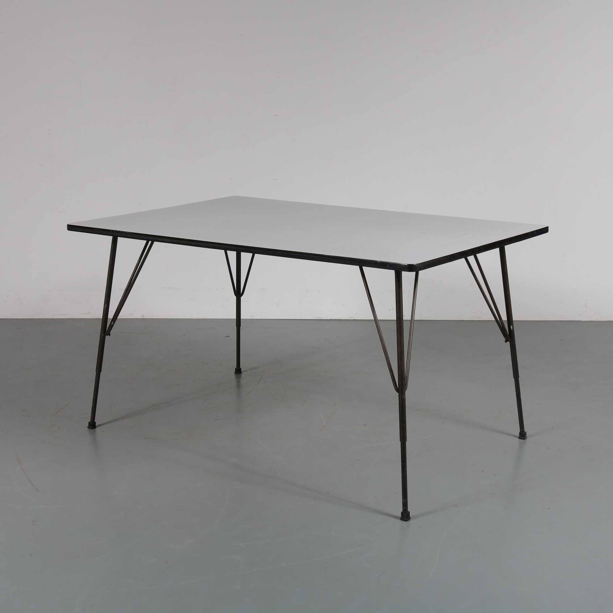 m22993 1950s Rectangular dining table on black metal legs with formica top, adjustable in height Rudolf Wolf(f) Elsrijk / Netherlands