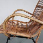 m23100 1960s Rattan easy chair on black metal base Dirk van Sliedregt Gebroeders Jonkers / Netherlands
