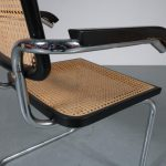 1970s Cesca dining chair in chrome plated tubular metal frame with woven rush upholstery and armrests Marcel Breuer Italy