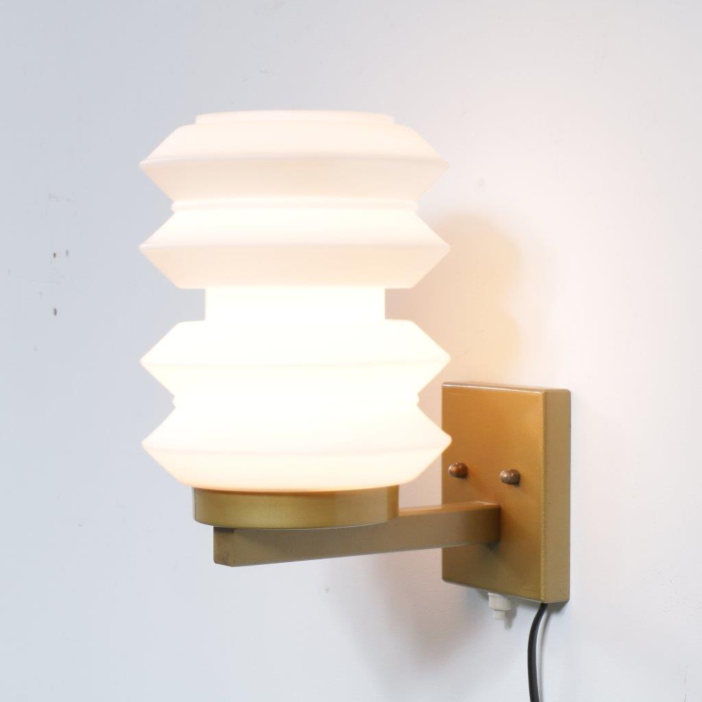L1989 1950s Beautiful shaped wall light by Raak, Netherlands