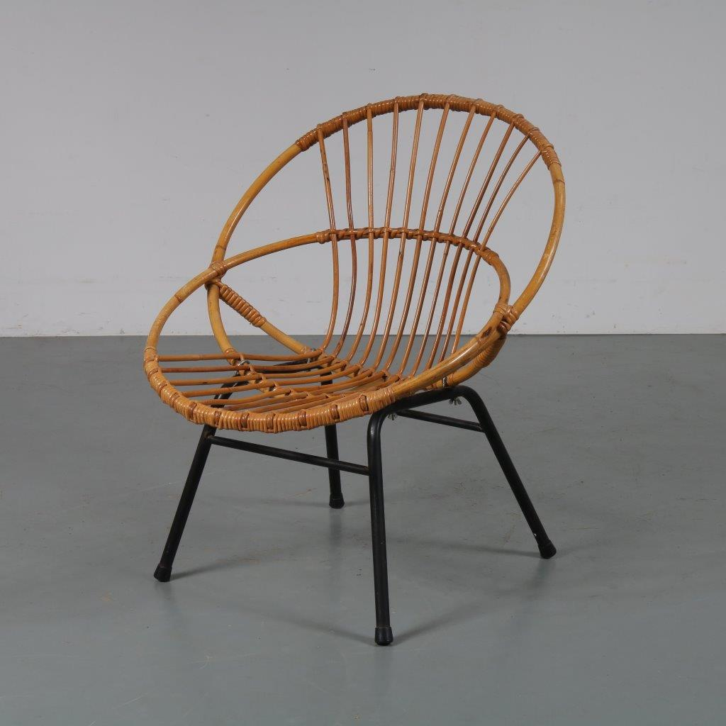 m23087 1950s Rattan chair on black metal base Dirk van Sliedregt Gebroeders Jonkers / Netherlands