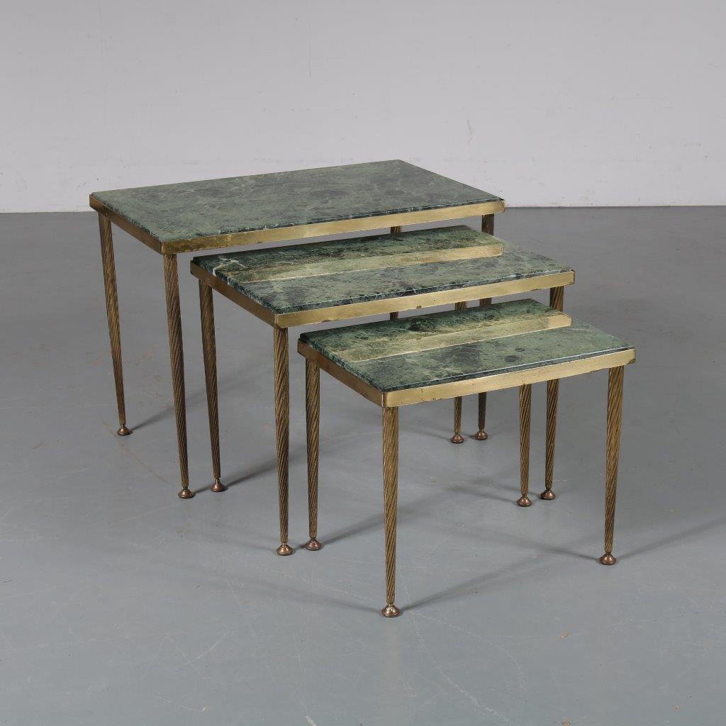 m23375 1960s Set of three nesting tables with brass base and green marble tops Italy