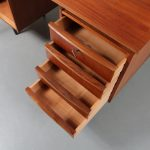 m23186 1950s Small teak desk on wooden legs with extendable writing platforms and two drawer units Netherlands
