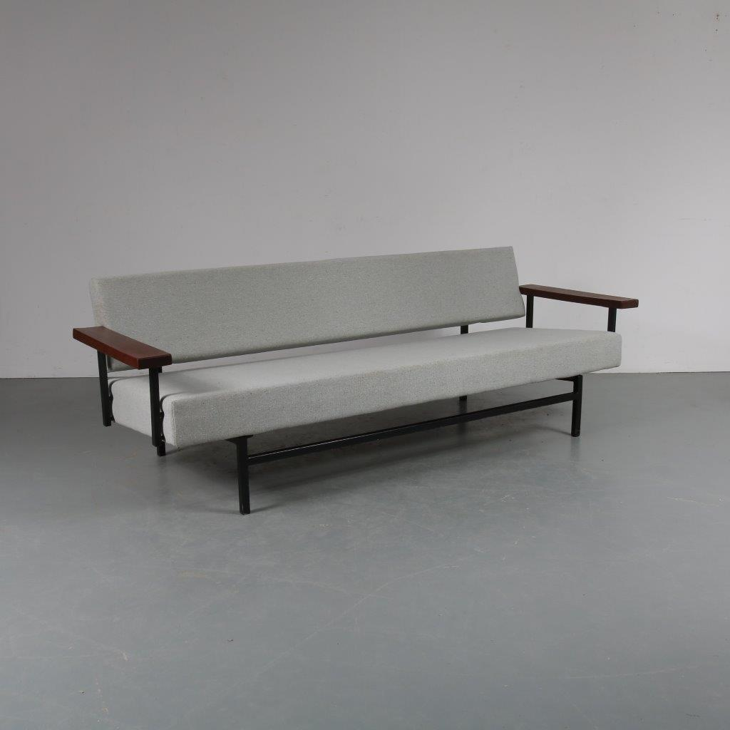 m23390 1950s Early edition three-seater sofa / sleeping bench on black metal frame with teak wooden armrests and new upholstery Rob Parry Gelderland / Netherlands