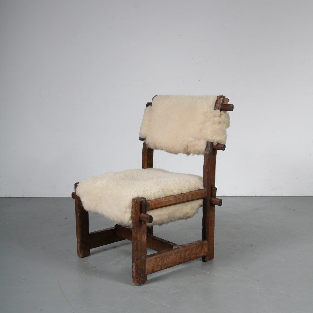 m23803 1950s Brutalist chair with sheepskin rug in the style of olavi hanninen