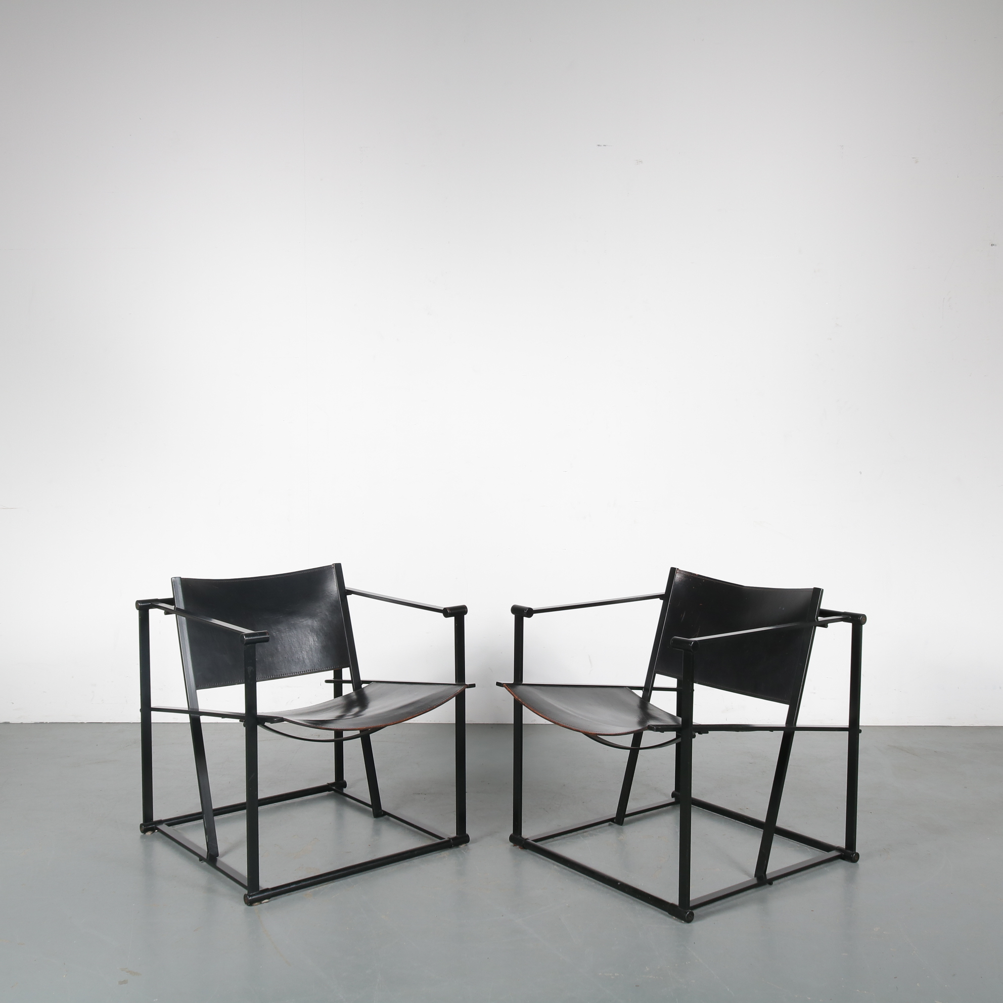 "m23823 1980s Set of 2 FM62 ""cube"" easy chair on black metal frame with black saddle leather upholstery Radboud van Beekum Pastoe / Netherlands"