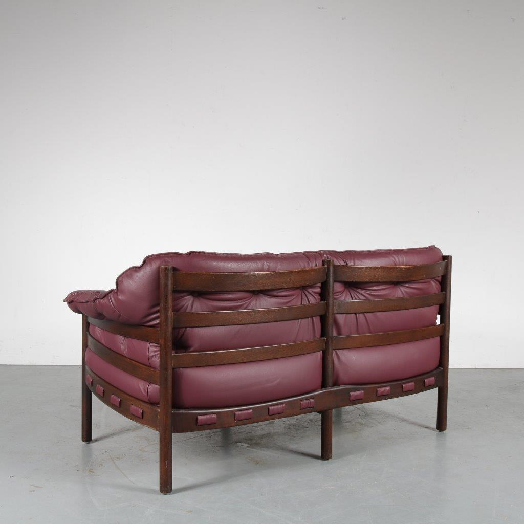 Two Seater Sofa On Dark Wooden Frame