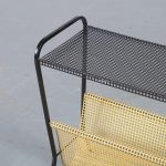 m23898 1950s Yellow with black perforated metal magazine rack Pilastro / Netherlands