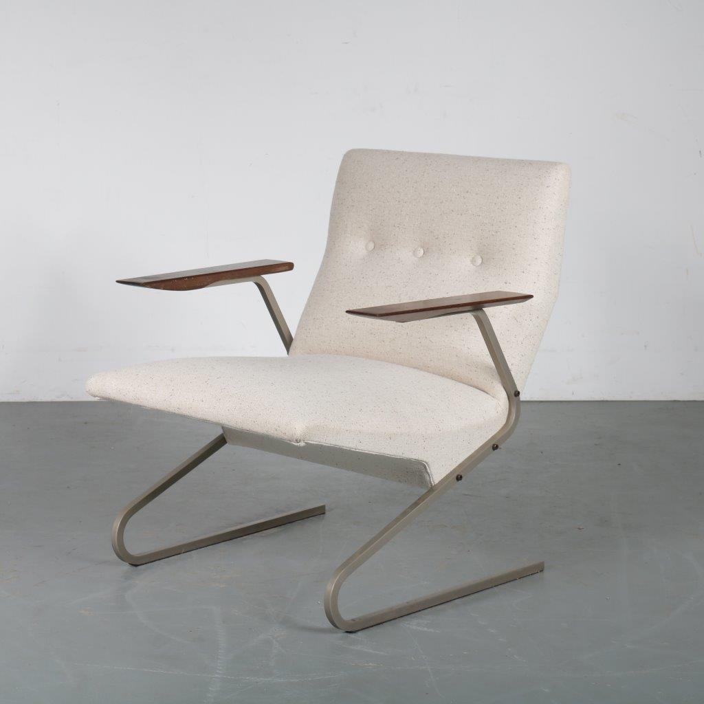m23693 1960s Unique easy chair on chrome metal base with teak armrests and new upholstery George van Rijck Beaufort / Belgium