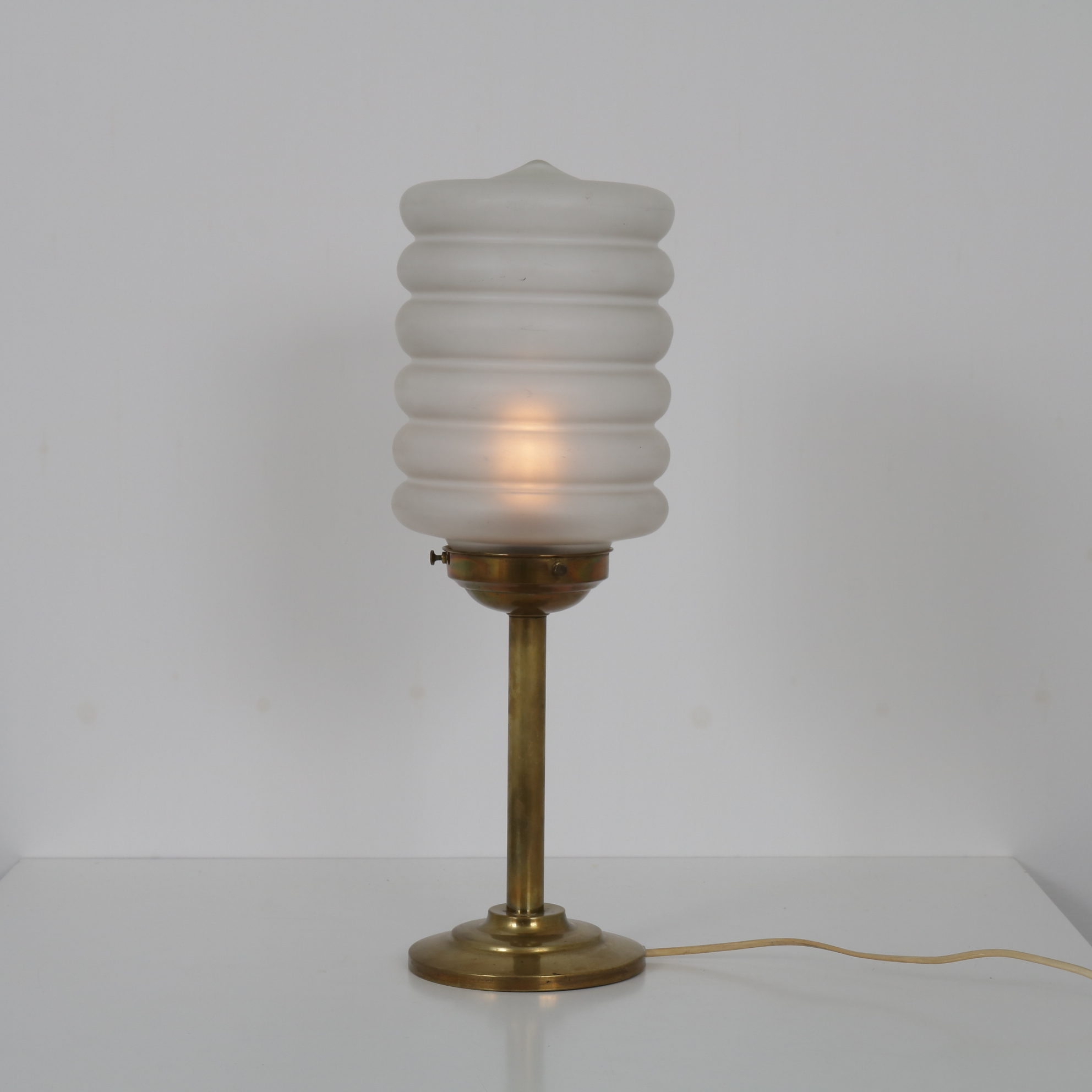 INC67 1950s Swedish table lamp on brass base with milk glass hood
