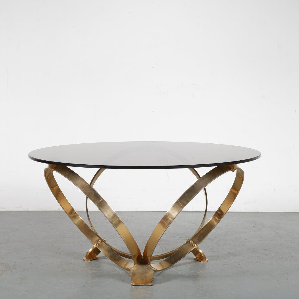 m24059 1970s Coffee table on brass base with smoke glass top in the style of Roger Sprunger Belgium