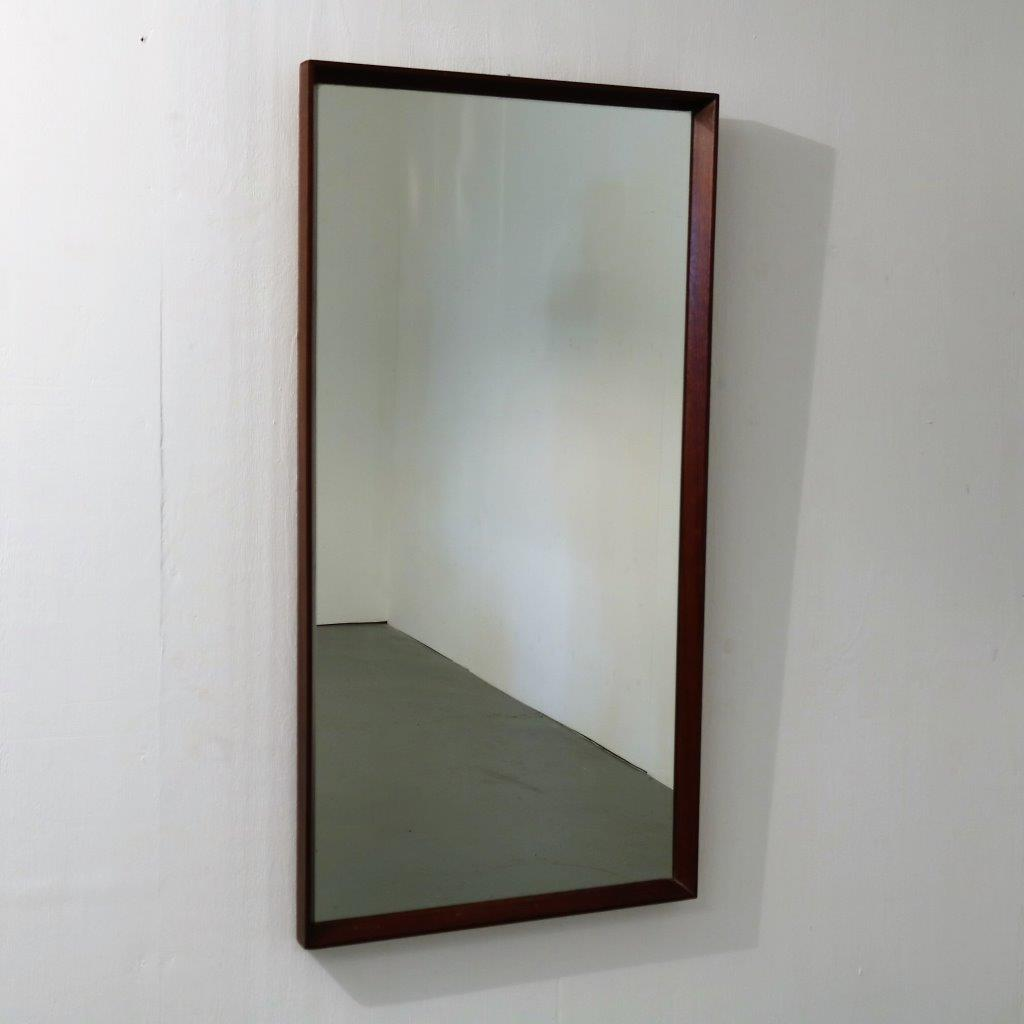m24086 1960s Rectangular shaped wall mounted mirror with teak edge Denmark