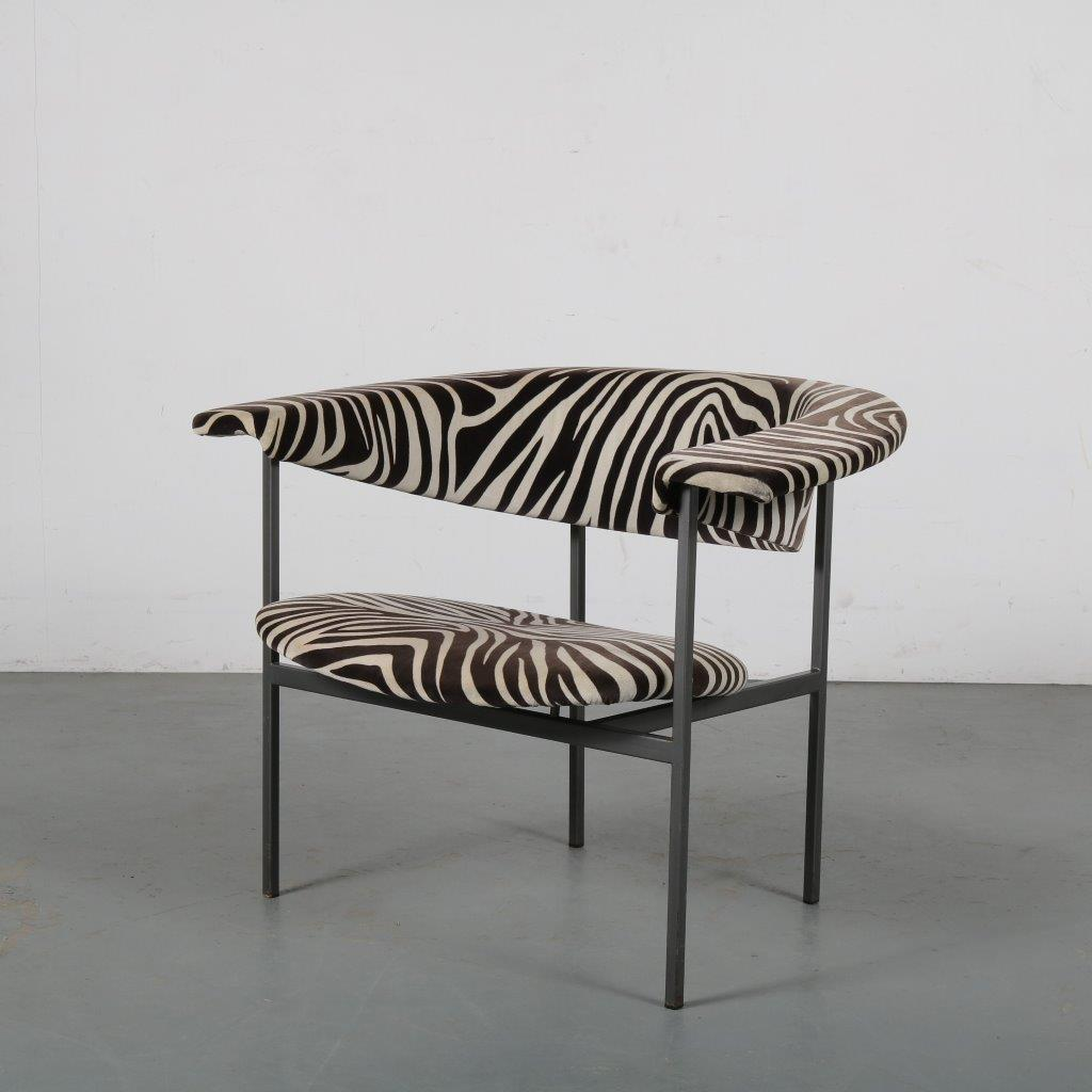 m24272 1950s easy chair on grey metal base with zebra print upholstry model gamma Rudolf Wolf Gaasbeek en van Tiel/NL