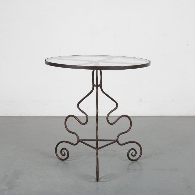 m23752 1950s Round cast iron garden table with glass top in the style of Andre Drouet France