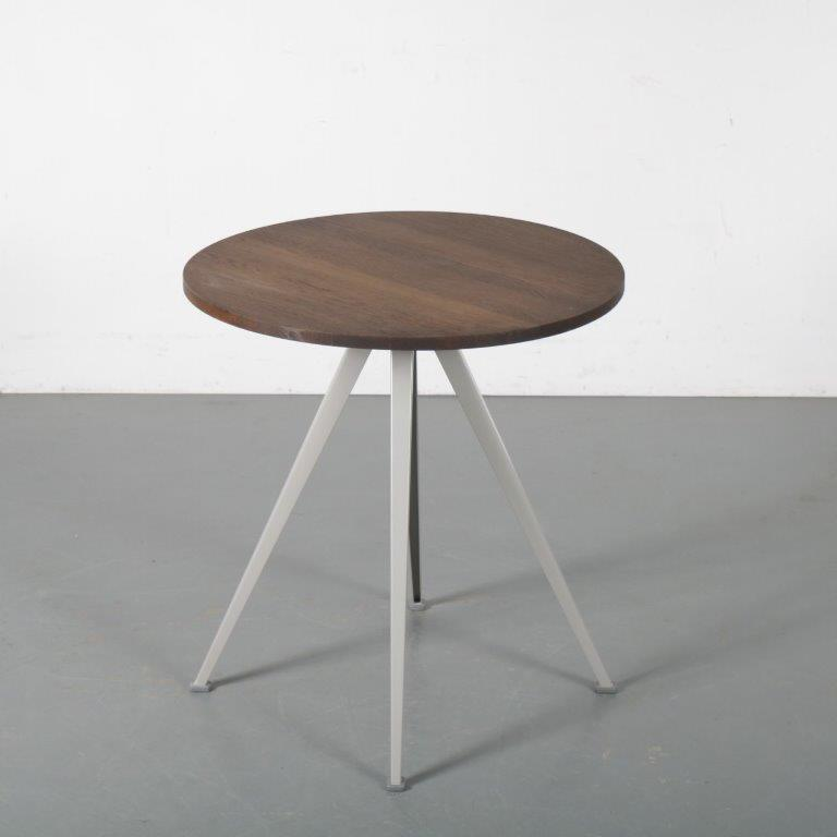 m24382 2000s small diner table on grey metal base and wooden round top Friso Kramer Hay / NL