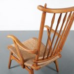 m24476 1950s Oak spokeback easy chair with rush seat De Ster / Netherlands