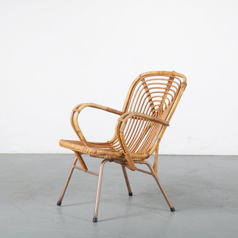 m24425 1950s Rattan easy chair on chrome metal base Gebr. Jonkers / NL