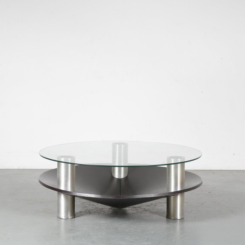 m24408 1970s round coffe table on alu legs with black plywood magazine rack and glass top Netherlands