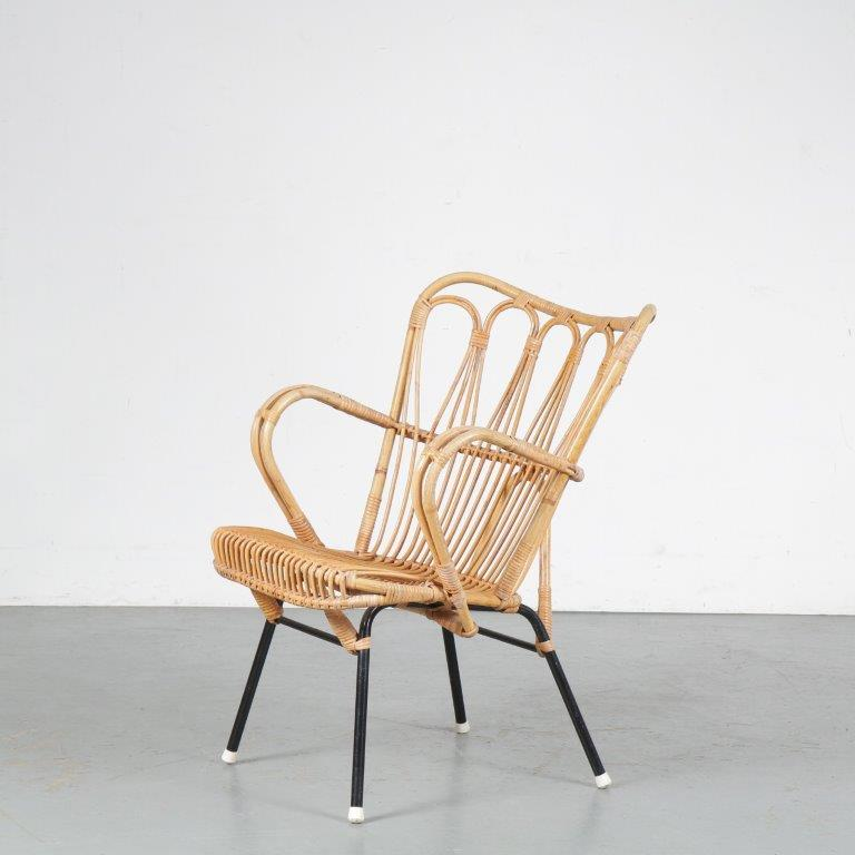 m24662 1950s Rattan easy chair on black metal base Dirk van Sliedregt Gebroeders Jonkers / Netherlands
