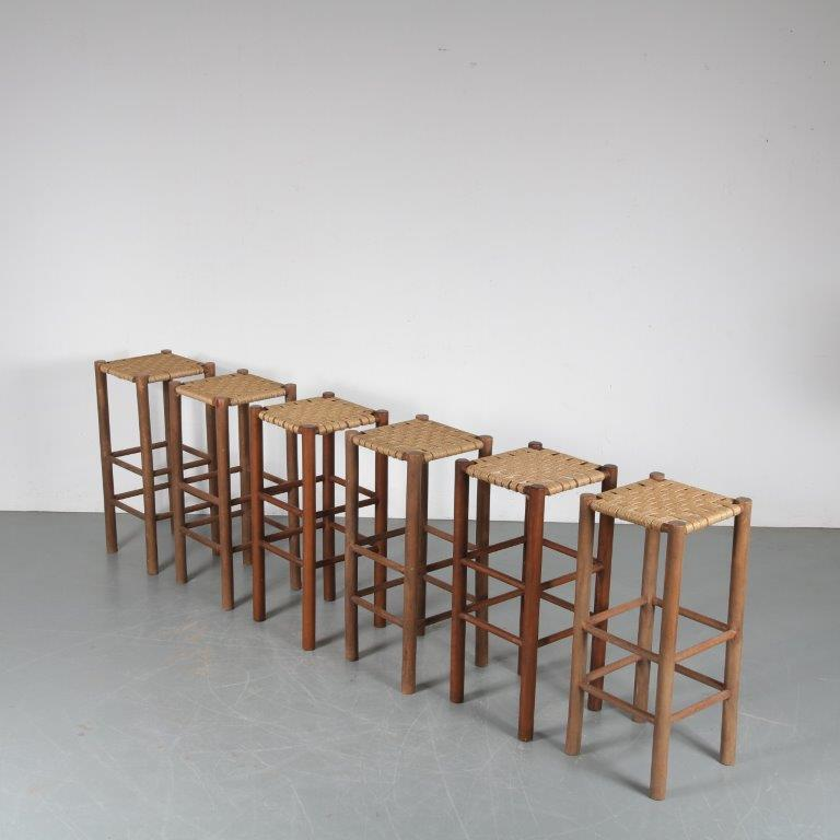 m24764 1950s Set of six wooden bar stools with rope upholstery in Perriand style France