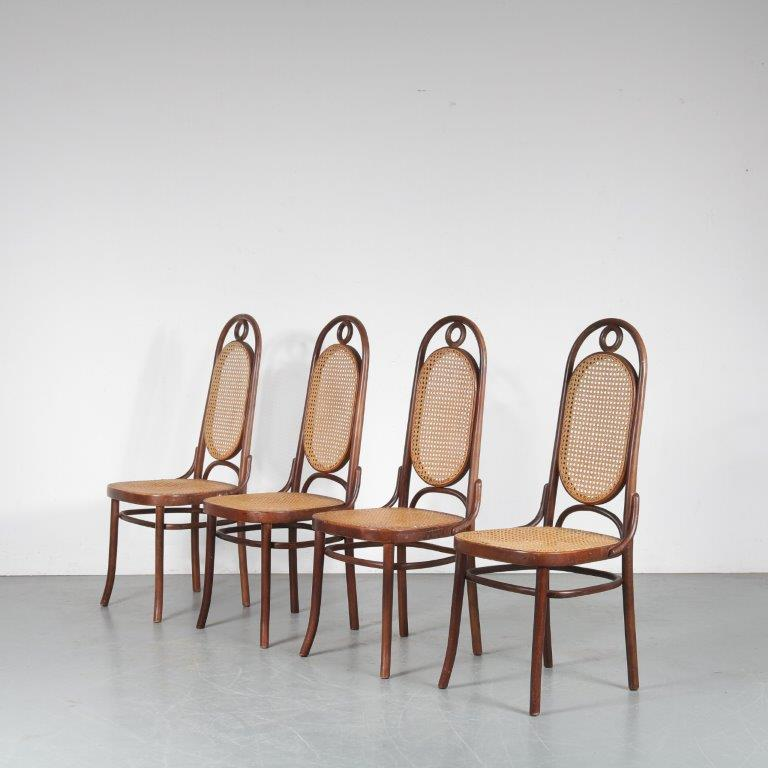 m24762 1950s Set of four bentwooden chairs with woven cane Thonet
