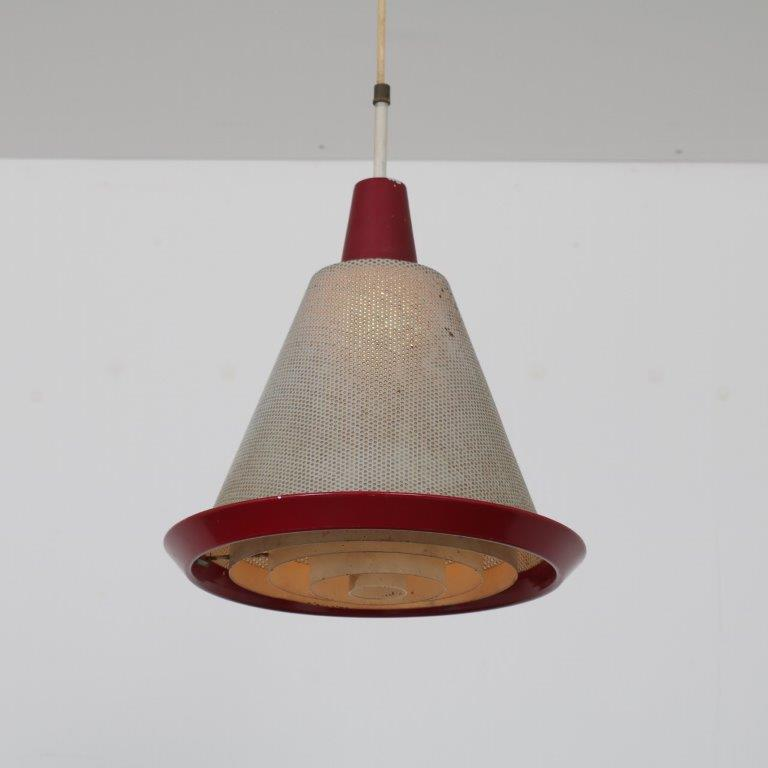L4619 1950s Hanging lamp with red perforated metal hood Artimeta Netherlands