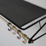 m22948 1950s Black and white lacquered metal coat rack with perforated top and coloured hooks, Matégot France