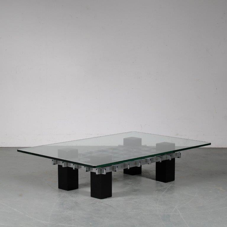 m24964 1960s Rectangular coffee table on chrome with black wooden base and glass top Milo Bauchman attributed USA