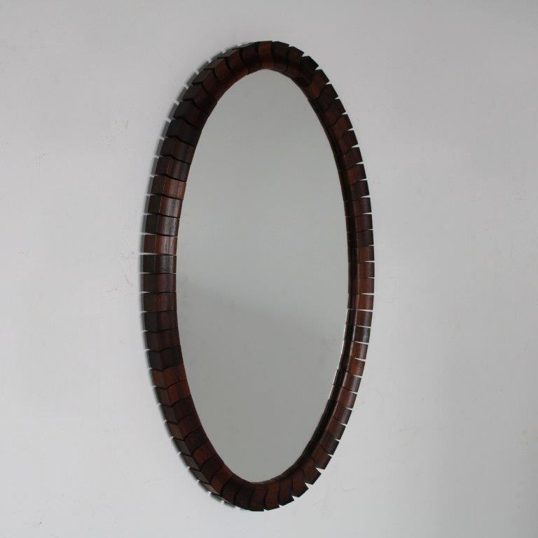 m25352 1960s Oval wall mounted mirror with edge of wood pieces Denmark