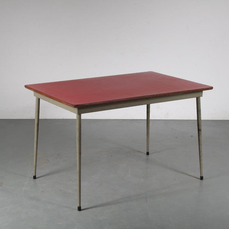 m25456-8 1950's dining table on grey metal base with red laminated top Willy van der Meeren Tubax BE