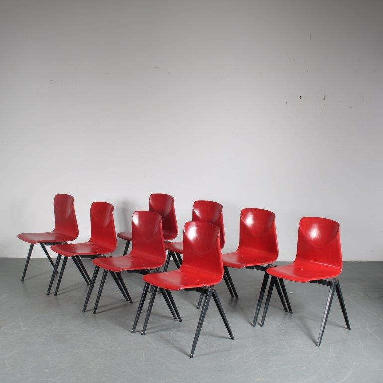 INC98 1970s Stock of 39 stacking chairs on black metal base with red pagholz seats, Galvanitas model S22