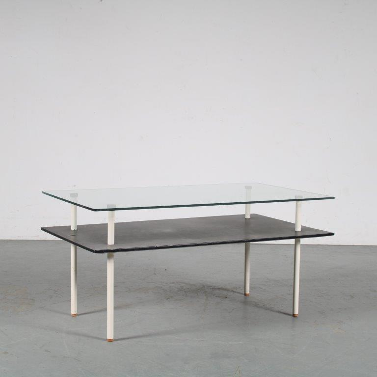 m25118 1950s coffee table on black metal legs with white wooden magazine shelf and glass top De Wit NL