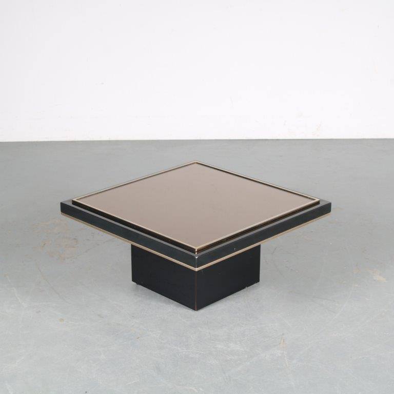 m25474 1980s black coffee table on thick black square base with small brass lining and black thick glass top small